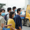 Unhappy citizens in face masks going to work